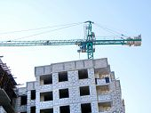 Self-erecting Crane Near The Building Under Construction. Construction Site Background. poster