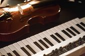 Listening Classical Music. Close-up View Of Classical Violin Instrument Lying On A Synthesizer. Musi poster