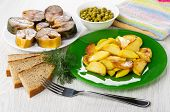Pieces Of Mackerel, Fried Potatoes In Green Plate, Bowl With Green Peas, Dill, Pieces Of Bread, Fork poster