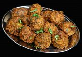Indian onion bhajis on stainless steel platter