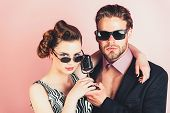 Beauty And Vintage Fashion, Music Band. Pinup Girl And Man On Pink Background, Radio. Music And Love poster
