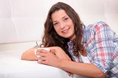 picture of futon  - Woman drinking hot drink - JPG