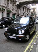 stock photo of cabs  - Classic London cab on a central street - JPG