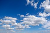 Blue sky and cloudscape with cumulus clouds