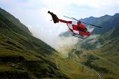 image of rescue helicopter  - Red search and rescue helicopter flying - JPG