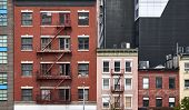 Old Tenement Houses With Fire Escapes In New York City, Usa. poster
