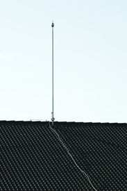 stock photo of lightning-rod  - Lightning rod on the roof - JPG