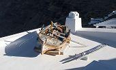 Old Fishing Boat On Terrace In Santorini Island