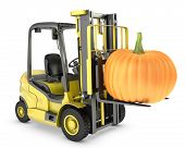 Yellow Fork Lift Truck Lifts Orange Pupmkin