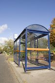 pic of bus-shelter  - a modern bus stop shelter with seats - JPG