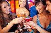 stock photo of congrats  - Portrait of joyful friends toasting at birthday party - JPG