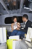 Couple toasting with champagne in limousine