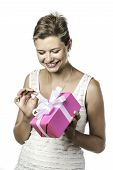 Young Pretty Woman Unwraps Gift