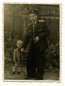 CEGLED, HUNGARY,  CIRCA 1958: Antique photo, portrait of a Red Army lieutenant and his son, circa 1958