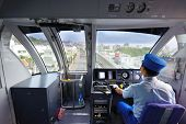 NAHA, JAPAN - NOVEMBER 12: A conductor drives the Okinawa Monorail November 12, 2012 in Naha, JP. Op