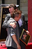 LOS ANGELES - JUL 16:  Frankie Muniz, Bryan Cranston at the Hollywood Walk of Fame Star Ceremony for