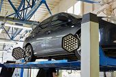 MOSCOW - AUG 22: Car on stand with sensors on wheels for wheels alignment camber check in workshop o