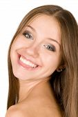 Close-up Portrait Of Smiling Young Beautiful Woman