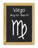 the zodiac sign Virgo on a blackboard