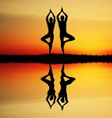 image of karma  - an illustration of a Yoga couple at sunset with reflection - JPG