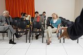 stock photo of boredom  - Multiethnic businesspeople sleeping during a seminar in conference room - JPG