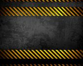 stock photo of hazard symbol  - black metal with warning stripes - JPG