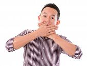 Asian man with big surprise expression, hand covering mouth, isolated on white background. Asian male model.