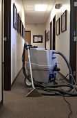 image of cleaning service  - a steam carpet cleaning machine in a long office hallway - JPG