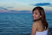 Woman Smiling On Seaview Background In Twilight