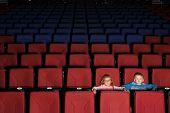 Two children in an empty cinema hall