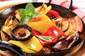 fried vegetable side dish in a black wok pan