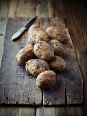 New potatoes on rustic wooden background