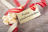 foto of weihnachten  - a golden label with the german words Frohe Weihnachten which means merry christmas - JPG
