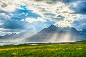 Sun is shining through the clouds on the fjord on the Iceland