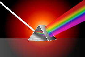 stock photo of prism  - prism refracting white light on a red background - JPG