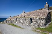 Two Traditional Blackhouses At Gearrannan Village, Isle Of Lewis