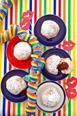 Fresh Beignets On Colorful Plates