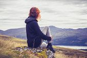 pic of wilder  - Woman is Relaxing On a Mountain Top - JPG