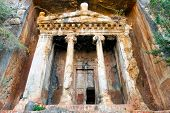 stock photo of rock carving  - Impressive Tomb of Amyntas Lycian Tombs carved in rock FethiyeTurkey - JPG