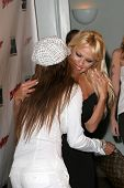 Traci Bingham and Pamela Anderson at the DVD Release of