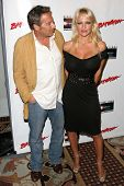 Pamela Anderson and friend at the DVD Release of