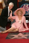 Ruta Lee and guest at the award ceremony honoring Ruta Lee with a star on the Hollywood Walk of Fame. Hollywood Blvd., Hollywood, CA. 10-10-06