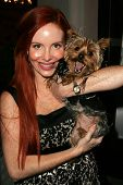 Phoebe Price and dog Henry at the first annual Beverly Hills Mutt Club Fashion and Halloween Show, B