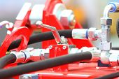 foto of hydraulics  - Hydraulic connections hoses of a machinery industrial detail - JPG
