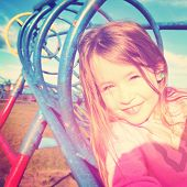 Adorable little girl outdoors in Summer instagram effect