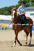 LYTKARINO, MOSCOW REGION, RUSSIA - JULY 12, 2014: Julia Lysenko of Moscow police warms up her horse during Russian championship in trick riding. Lytkarino housed the Russian Federation of trick riding