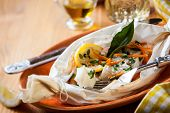 Cod fillets  baked in parchment paper