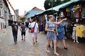 Shoppers walk through Chinatown in Singapore