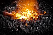 Conceptual image of a hot iron in burning coals