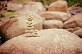 Stone Made Tower On River. Balance In Nature